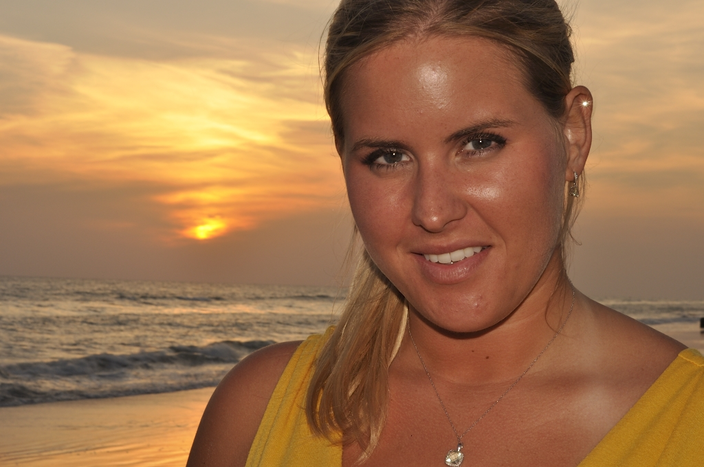 Gallery: Blonde hair girl at the beach at sunset