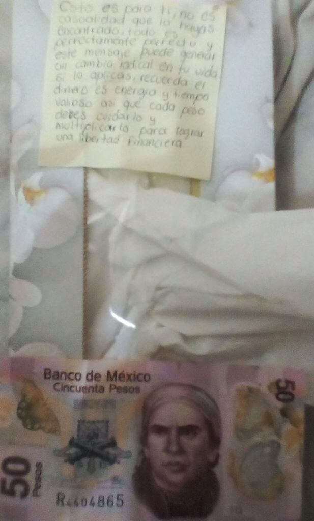Note and money in tissue box