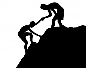 A person helping another person climb a steep hill
